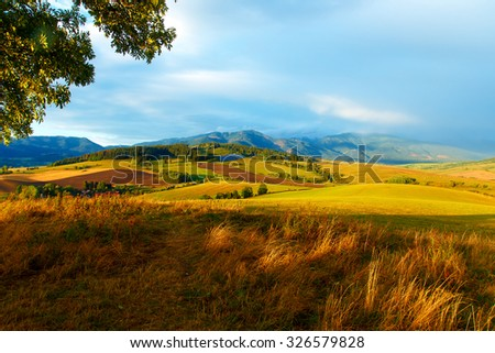 Solar power plant in the mountains on meadow. Beautiful landscape scenery. - stock photo
