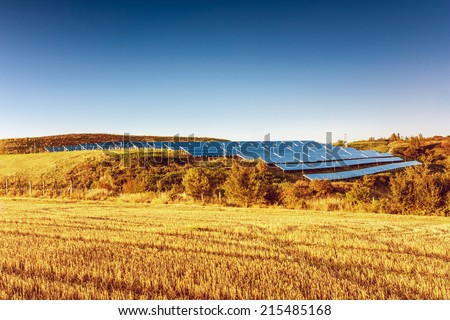 Solar power plant on background with blue sky - stock photo
