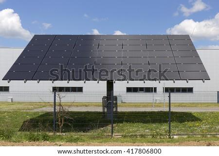Solar Power Station on the spring flowering Meadow  - stock photo