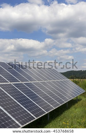 Solar Power Station on the summer flowering Meadow  - stock photo
