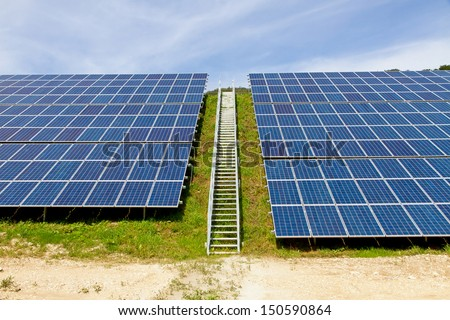 Solar power station with service stairway - stock photo