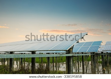 solar power station with sunset glow, beautiful background of new energy. - stock photo