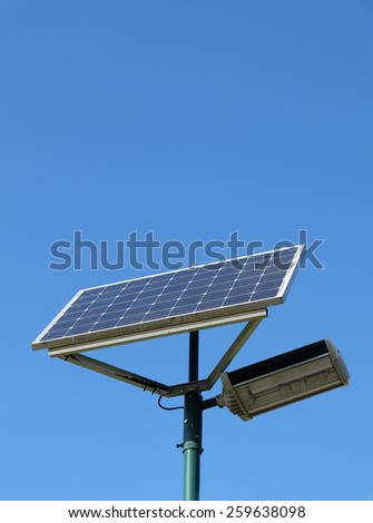 Solar powered street lamp against clear blue sky
