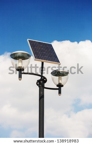 Solar powered street lights, cloudy sky background