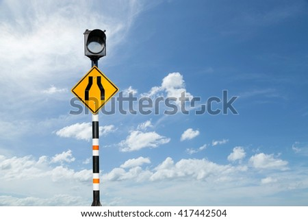 Solar powered traffic signs,Road narrows sign  on blue sky background - stock photo