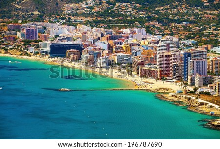 Solar Sea coastline with having a rest people on the background of colorful resorts (Costa Brava, Spain) - stock photo