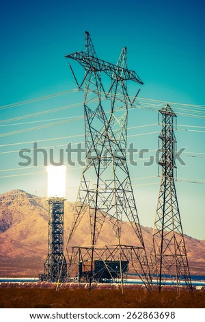 Solar Thermal Power Plant and High Voltage Infrastructure. Energy Industry Theme.  Concentrated Solar Thermal Plant in the California Mojave Desert, United States. - stock photo