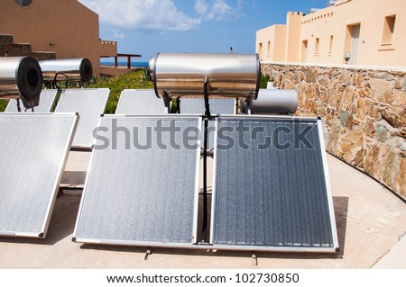 Solar water heater on roof - stock photo