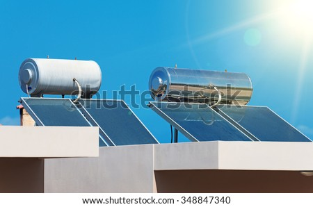 Solar water heating system on the rooftops. - stock photo