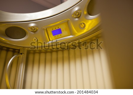 Solarium. Stand up tanning system interior showing control panel - stock photo