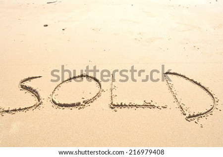 Sold in Sand - stock photo