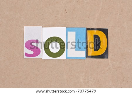Sold, letters sorted on paper background