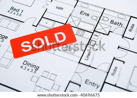 sold sign on house plan - stock photo