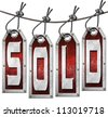 Sold Tags Hanging on White Background / Grunge metallic and red tags hanging on a steel cable with written sold - stock photo