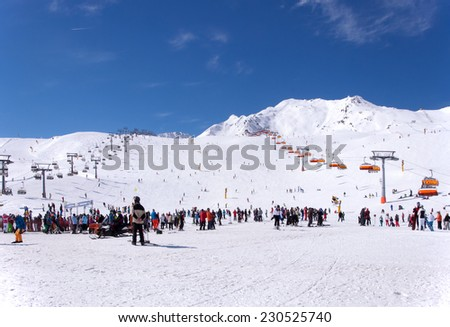 SOLDEN, TIROL, AUSTRIA - MARCH 10, 2013: Crowd of skiers and chairlifts in Alpine ski resort in Solden in Otztal Alps, Tirol, Austria - stock photo