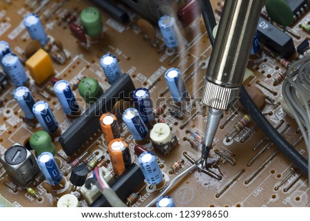 Soldering iron and verification testing of electronic boards - stock photo