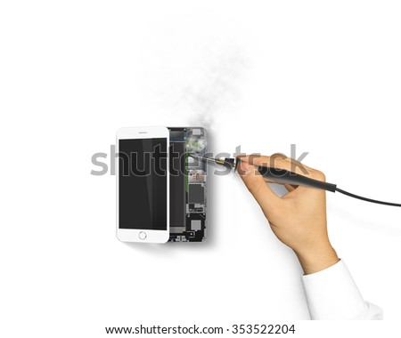 Soldering iron holding hand isolated. Solder repair phone on hot temperature. Soldering tool with power. Phone soldering isolated, chip, motherboard, processor, cpu and details. Broken device mending. - stock photo