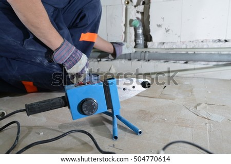 Soldering tools for plumbing pipe, the plumber working on the background