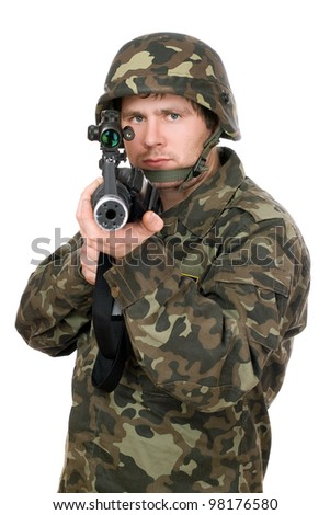 Soldier aiming a rifle in studio. Closeup - stock photo