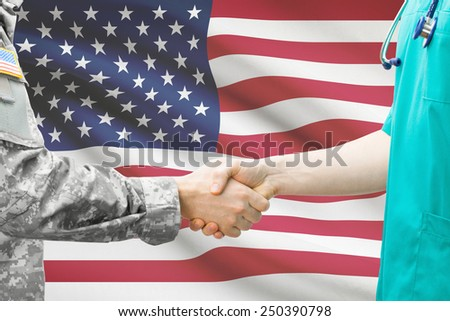 Soldier and doctor shaking hands with flag on background - United States - stock photo
