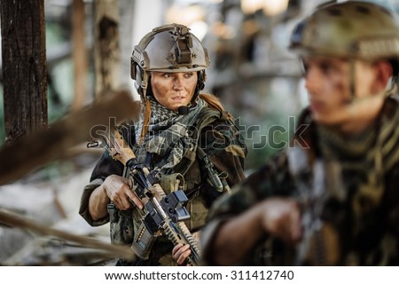 soldier and his wife at the battlefield area - stock photo