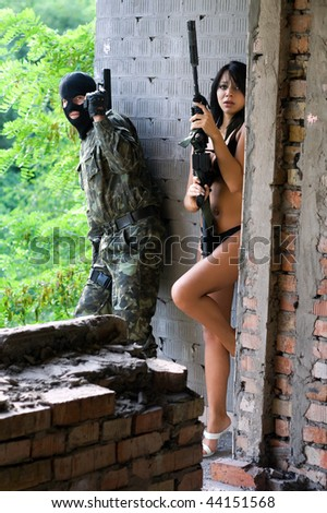 Soldier and naked scared woman in ambush