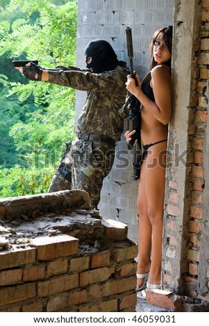 Soldier and young frightened woman in ambush