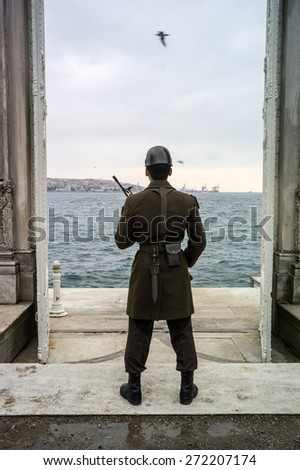 Soldier between Eropa and Asia, Istanbul - stock photo