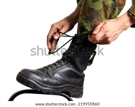 Soldier binds shoes - stock photo