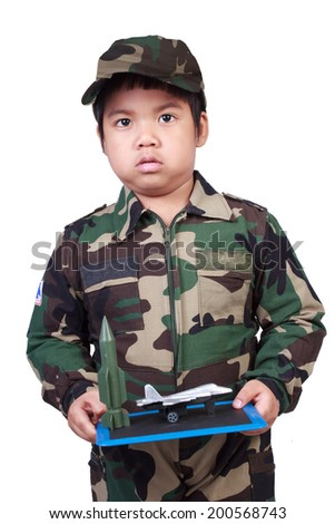 soldier boy holding battle plan on white background with clipping path