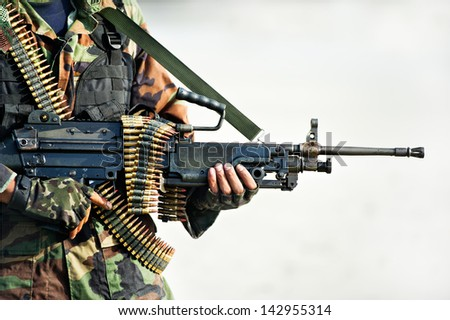 soldier carrying  big gun  in combat training - stock photo