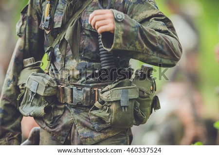 Soldier, commando standing, ready for combat training.