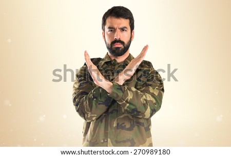 Soldier doing NO gesture  - stock photo