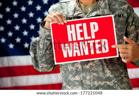 Soldier: Female Soldier Holding Help Wanted Sign - stock photo