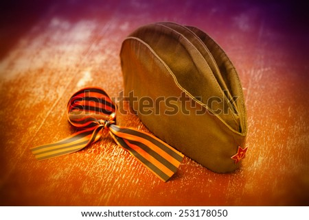 soldier field cap with a red star and George Ribbon. Feast of May 9 Victory Day. Anniversary - 70 Years of Victory - stock photo