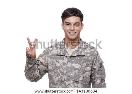 Soldier gesturing victory  - stock photo