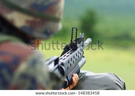 Soldier Gunman Aiming His Target - stock photo