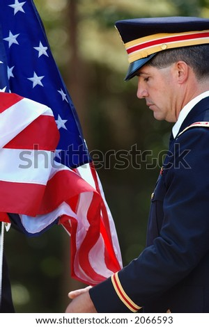 Soldier helping raise the American flag