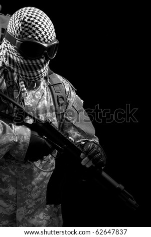 soldier holding a gun, isolated in black, monochrome