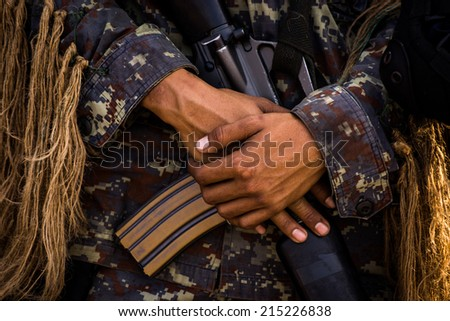 Soldier Holding a Machine Gun - stock photo