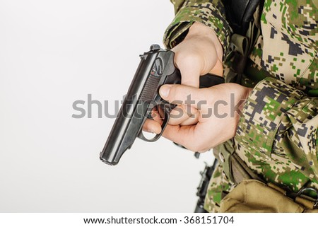 Soldier holding a russian 9mm handgun PM (Makarov). Training of soldiers firing pistol . - stock photo