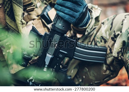 soldier holding modern weapon  carbine