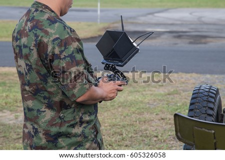 Soldier Holding Remote Controller In Hands Close Up Male Piloting Rc Car