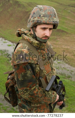 Soldier in heavy combative ammunition