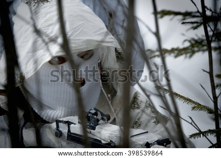 Soldier in the forest undergrowth. Sniper in the woods - stock photo