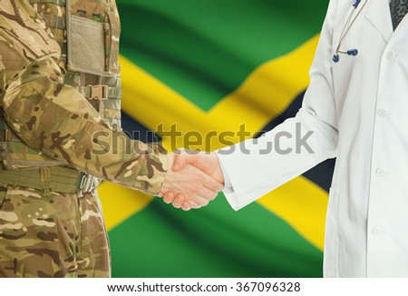 Soldier in uniform and doctor shaking hands with national flag on background - Jamaica - stock photo