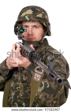 Soldier keeping a rifle in studio. Isolated