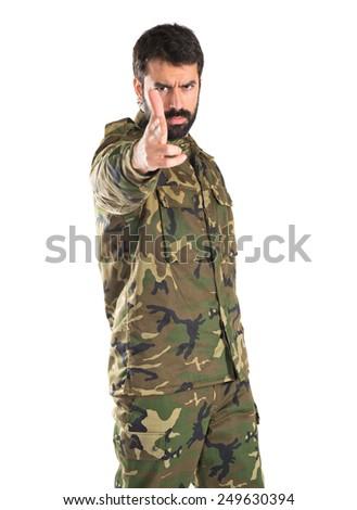 Soldier making gun gesture  - stock photo