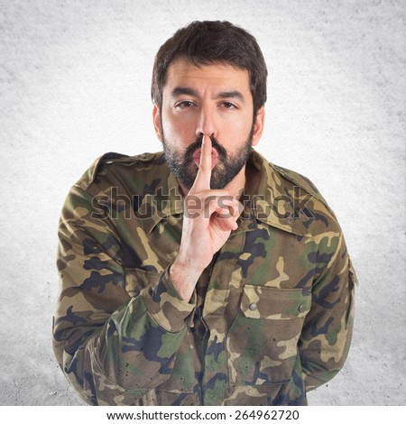Soldier making silence gesture  - stock photo