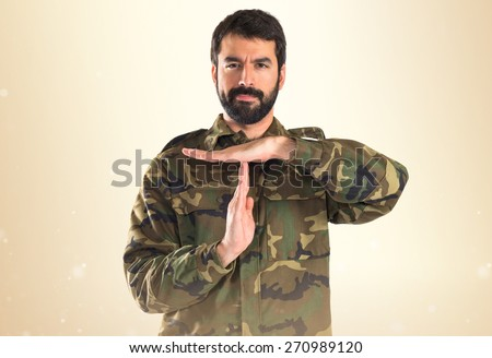 Soldier making time out gesture   - stock photo